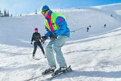 Skier. Young male skier turning in powder snow; horizontal orientation Royalty Free Stock Image