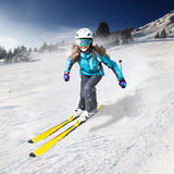 Skier. A female skier on the piste in Alps,  Europe Royalty Free Stock Photography