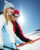 Skier. Happy girls on skies resort Royalty Free Stock Photography