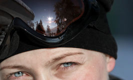 Skier. Girl wearing goggles looking straight at the camera Royalty Free Stock Photo