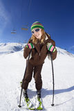 Skier. Female skier leaning on sticks and smiling Stock Photo