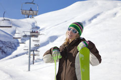 Skier. Female skier leaning on skis and smiling Stock Photos