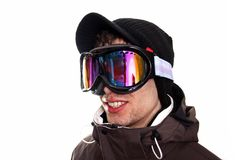 Skier. Young man wearing ski clothes Royalty Free Stock Image