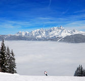 Skier above the clouds Stock Images