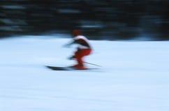 Skier in action 6. Skier in focus. Motion panned shot, on Velvia ISO 100, slightly grainy Stock Image