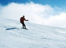 Skier in action 7. Skier descending a slop. Shot on Velvia ISO 100, slightly grainy Stock Photo