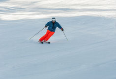 Skier in action. Amateur skier cornering during a descent Stock Image