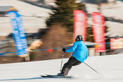 Skier in action. Amateur skier cornering during a descent. blurred background Royalty Free Stock Photo