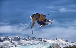 Skier in Action. Professional skier getting air out off a jump in competition. Mammoth Mountain, California Stock Photo