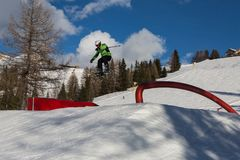 Skier in Action: Ski Jumping in the Mountain Snowpark.  Stock Images