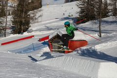 Skier in Action: Ski Jumping in the Mountain Snowpark.  Royalty Free Stock Photography