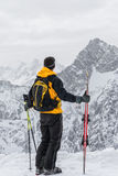 Skier admiring the mountains Royalty Free Stock Photos