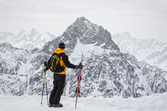 Skier admiring the mountains stock images