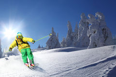 Skier against blue sky. Skier  against blue sky and sunset  in high mountain Royalty Free Stock Photos