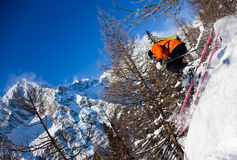 Skier in air. Young male freeride skier goes downhill in powder snow Mont Blanc Courmayeur Italy Stock Photography