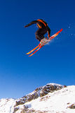 Skier in the air. Skier doing a big air in snow park at ski resort. Trademarks have been removed Stock Photo