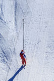 Skier ascend the slope. At the ski lifts stock images
