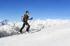 Skier ascending to the top royalty free stock images