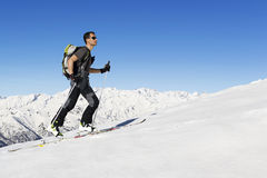 Skier ascending to the top royalty free stock photos