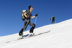 Skier ascending to the top royalty free stock photo