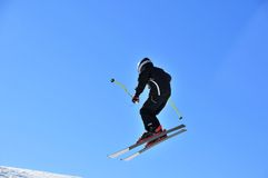 Skier in black jumping Stock Photography