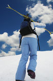 Skier on the blue background Royalty Free Stock Photo