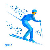 Skier with blue patterns running downhill Royalty Free Stock Image