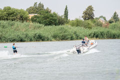Skier and boat on the Riet River Stock Image