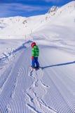 Skier boy on the slope Stock Image