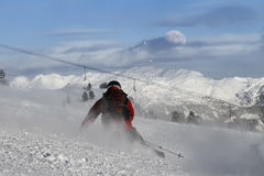 Skier carving. Skier is carving on a slope with daylight moon on horizon Royalty Free Stock Image