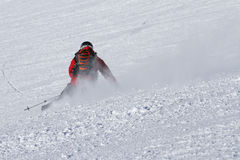 Skier carving on piste Royalty Free Stock Image