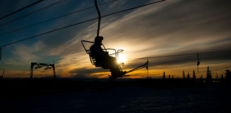 Skier on chair lift Stock Photo