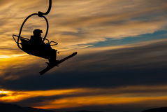 Skier on chair lift Stock Photography