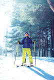 Skier child boy in sportswear with ski over winter Royalty Free Stock Photography