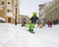 Skier on a city street Stock Images