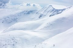 A skier is climbing the mountain ridge stock photography