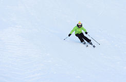 Skier coming down the slope Stock Photo