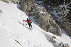 Skier in the couloir royalty free stock image