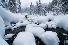 Skier crossing the river Royalty Free Stock Photo
