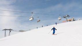 Skier Cruising Down the Mountain Stock Photo