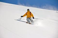 Skier in deep powder, extreme freeride royalty free stock photo