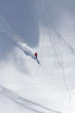 Skier in deep powder, extreme freeride. Skier in deep powder, extreme mountain freeride Royalty Free Stock Photo