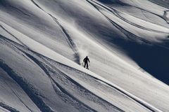 Skier in deep powder, extreme freeride. Skier in deep powder, extreme mountain freeride Royalty Free Stock Photography