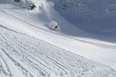 Skier in deep powder, extreme freeride. Skier in deep powder, extreme mountain freeride Royalty Free Stock Photos