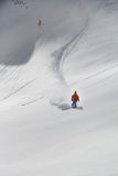 Skier in deep powder, extreme freeride. In the mountains Stock Photo
