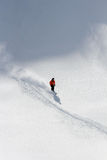 Skier in deep powder, extreme freeride. In the mountains Stock Photos