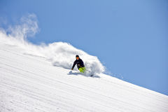 Skier in deep powder, extreme freeride royalty free stock image