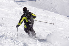 Skier in deep powder, extreme freeride. Skier in deep powder, extreme winter freeride Royalty Free Stock Photography