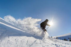 Skier in deep powder. On a steep slope Royalty Free Stock Images