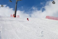 Skier descend on snowy ski slope at sun winter day. Greater Caucasus, Shahdagh, Azerbaijan stock photo